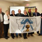 Presenting the Municipal District of Fairview No. 136 flag to Mayor Ernest Simms of St. Anthony. (L to R) Joe Gans, Jon-Anne Gans, Marg Wieben, Don Wieben, Karen Wilson, Brian Wilson, Norbert Luken and Mayor Ernest Simms.